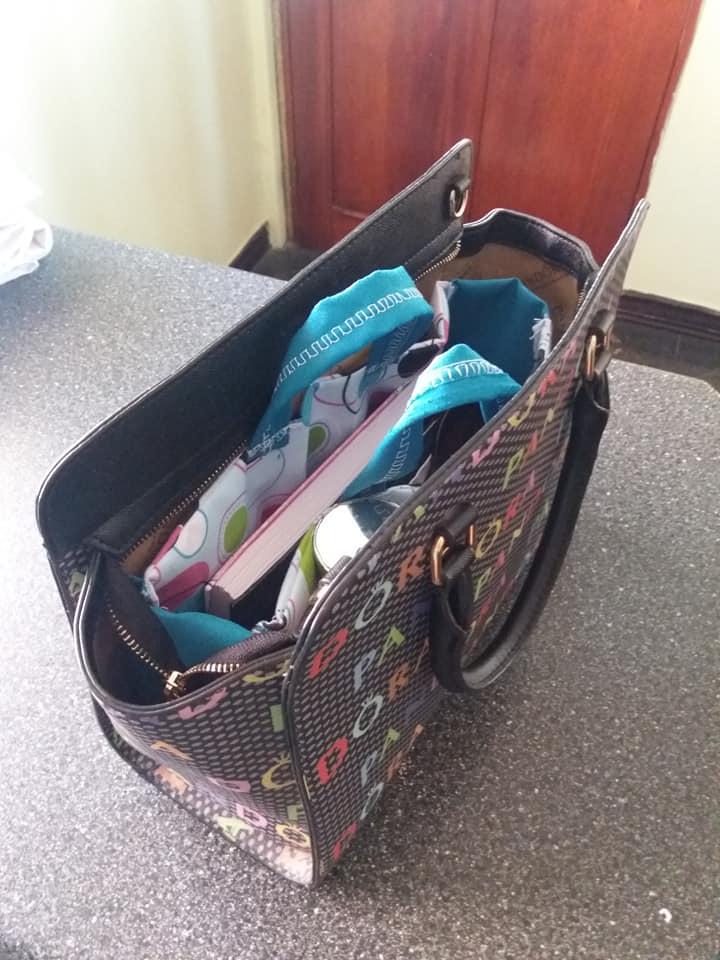 Estuches organizadores para bolsos y carteras